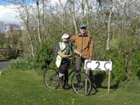 Cycling scarecrow and friend